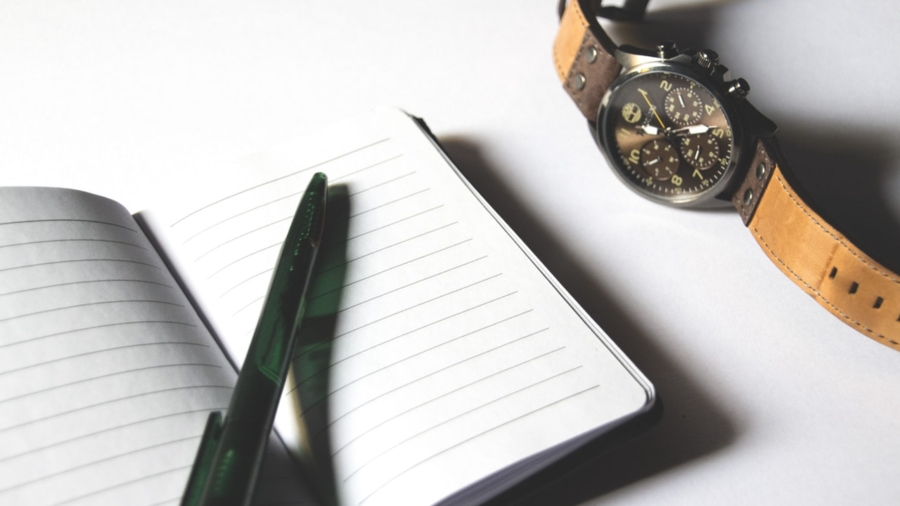 pen, paper, and watch for the job interview preparation