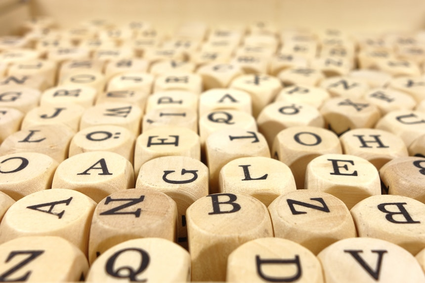Random word factory cubes and letters signifying overused resume phrases