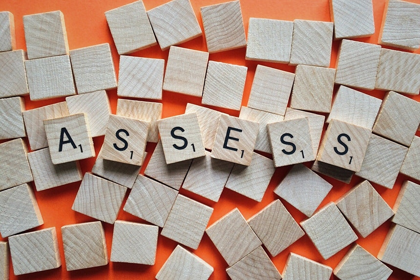 Scrabble tiles forming the word assess to show resume assessment