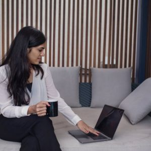 A job offer being contemplated on by a brunette woman in front of a laptop