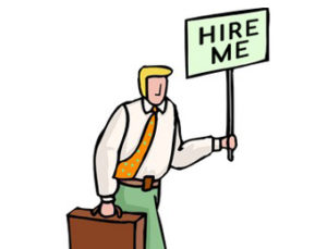 "man holding a ""hire me"" signage"
