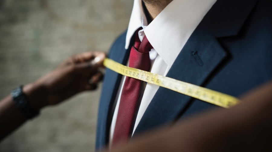 tailor measuring man's chest like custom resume writing
