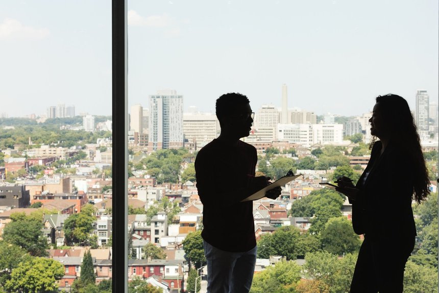 Silhouette of man and woman in the office talking about how to spot the right recruiter