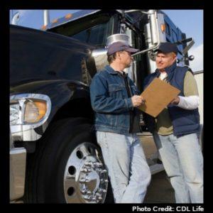 Tractor-Trailer Truck Driver discussing work