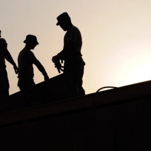Silhouette of 3 construction laborers as one of the best paying temporary jobs