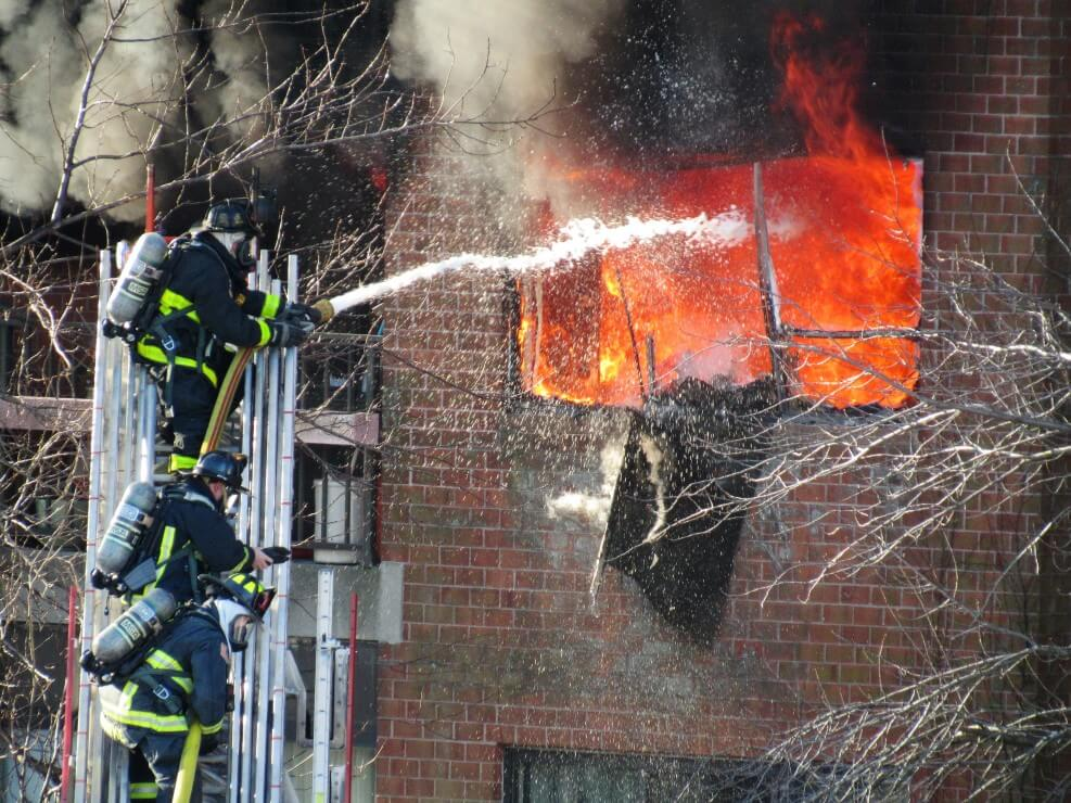 Firefighters extinguishing fire as an example of terrifying jobs