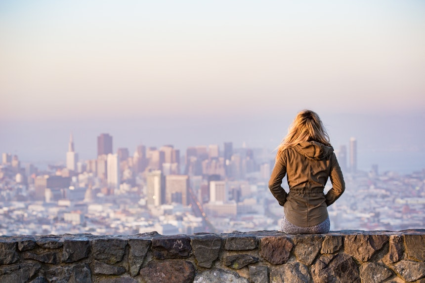 back view of a girl over looking buildings while thinking of the best resume writing service