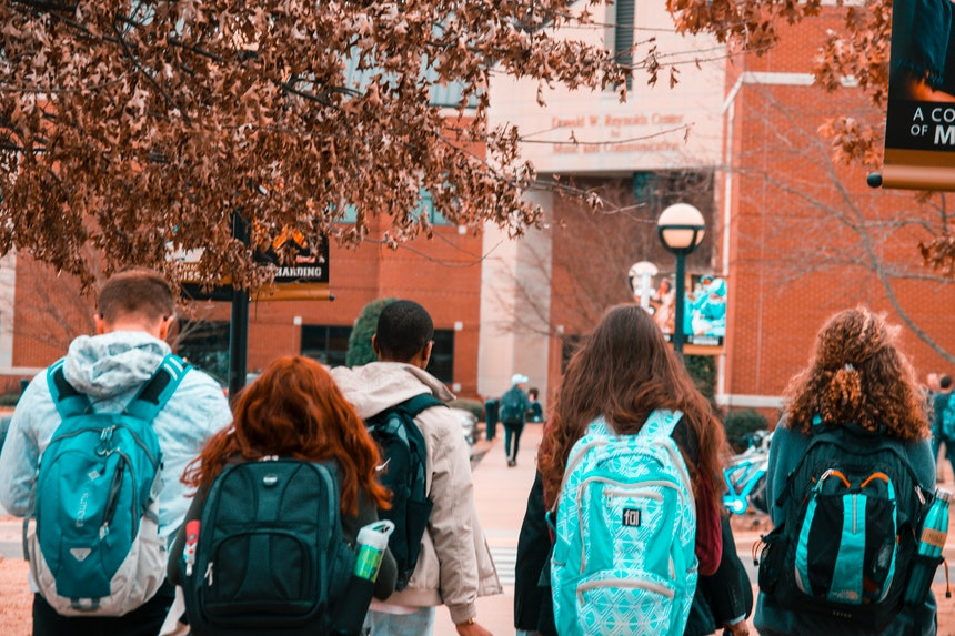 A group of college students carrying their backpacks to prepare for their future job