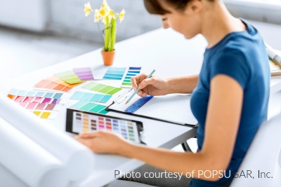 female graphic designer choosing colors