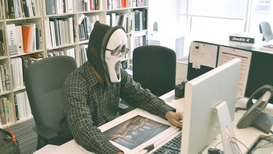 man wearing a mask in front of a computer hiding resume writing truths