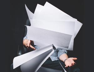 male employee managing heavy workload