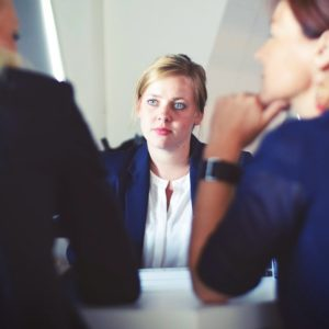 Female applicant showing bad job interview antics in front of two female interviewers