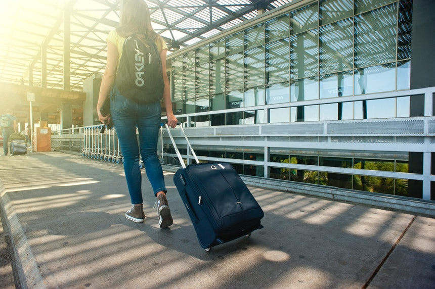 woman walking away with suitcases and the best career change resume