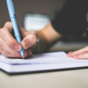 man listing the tips from the best professional resume writing services