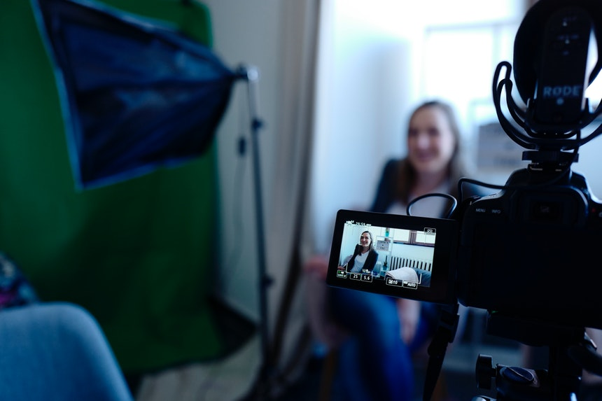 woman sitting in a couch while shooting a professional video resume