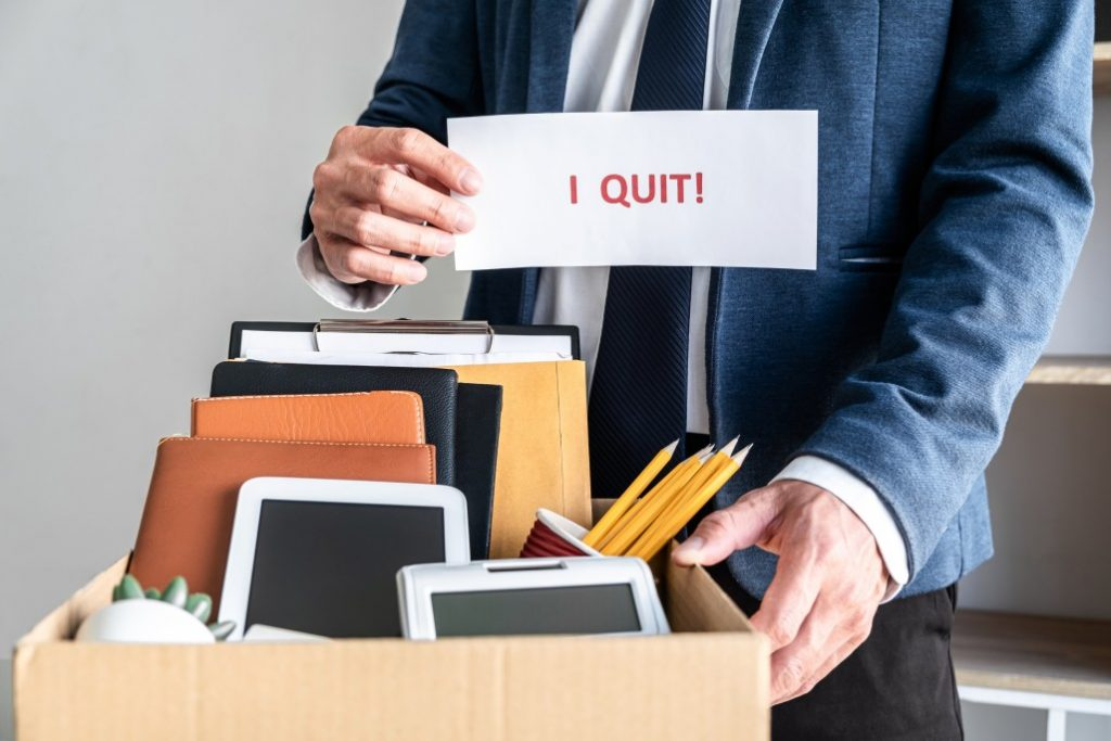 Man quitting with his office things as an example of people quit their jobs